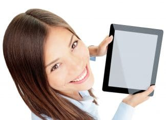 Tablet woman. Woman holding tablet computer touch pad with copy space isolated on white background. Beautiful mixed-race Asian Chinese / Caucasian female business woman.